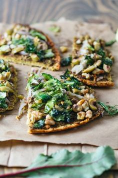 delicious socca + beet top pesto: flat-bread style, with brussels sprouts, olives, shallot.