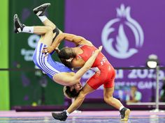 Tarik Belmadani of France throws Victor Ciobanu of Moldova during the men's 59kg Greco-Roman wrestling bronze medal bout at the Baku 2015 European Games in Azerbaijan.  Srdjan Suki, EPA