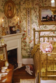 Victorian bedroom.  This is so pretty.  I love the lit candles on the mantle with tiny pictures of someone's beloved family.