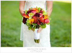 Gorgeous large bouquet of fall colors ranging from deep purple to persimmon orange