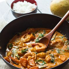 Thai Red Curry with Shrimp, mangoes, and sweet potatoes. It's a one-pot wonder!