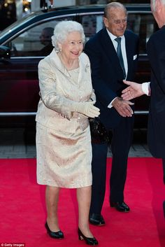 Your public awaits: The Royal couple gleefully greeted attendees as they arrived at the ev...