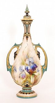A large early 20th Century Hadleys Worcester vase circa 1901 of footed ovoid form with a drawn tapered neck with applied foliate scroll handles all below a shallow domed cover with tall spire form finial, hand enamelled by Sedgley with flag Iris, grasses and insects within turquoise, blue, green and gilded borders,