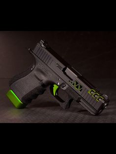 Personalized Black and Green Glock for our Police or any Law Enforcement Officers ( LEO ). This custom made glock is truly a piece of work which is both functional and cool to look at. Zombie Weapons, Weapons Guns, Airsoft Guns, Guns And Ammo, Zombie Apocalypse, Ninja Weapons, Military Weapons, Armas Airsoft, Glock 9mm