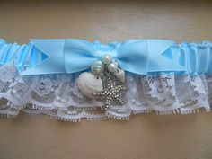 SOLD - Beach wedding garter set in blue with crystal by ArtHouseBridal, $24.95             THIS IN PINK!!!!!!