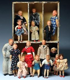 Doll House Sized .All with composition heads, most with molded hair and painted features, on cloth-wrapped wire armature bodies with metal hands and feet, in original clothing, probably by Caco and other makers. 3 mothers, 2 fathers, 2 grandparents, 9 children and 2 other miscellaneous dolls. Some are very good condition, and some have some wear. Altogether an interesting lot! Size Box: 11'' x 7''.