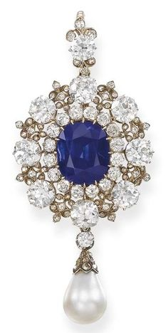 AN IMPORTANT ANTIQUE SAPPHIRE, DIAMOND AND PEARL PENDANT/BROOCH. The central cushion-shaped sapphire weighing 13.86 carats within the old-cut diamond eight-stone surround to the fleur-de-lys spacers and surmount, suspending a drop-shaped pearl with diamond-set cap, mounted in silver and gold, circa 1885, 7.7 cm. high. Lady Helen Hermione Blackwood (1865-1941), the eldest daughter of the 1st Marquess of Dufferin and Ava, Viceroy of India, and thence by descent. #antique #Victorian #pendant
