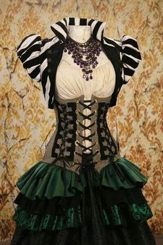 Looks like Damsel in this Dress. Could work for my gypsy costume. Love the ruffles! And this little jacket, too!