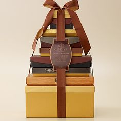 Godiva's new Chocolate Premiere Tower -- nearly EIGHT POUNDS of WW-busting chocolate. I can't find Godiva on my WW app, so I'm assuming a whole tower would blow all my flex points through 2013.