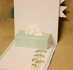 Now that's a brilliant pop up card! Here are instructions: http://limit5.blogspot.com/2013/03/a-kleenex-box-get-well-card.html