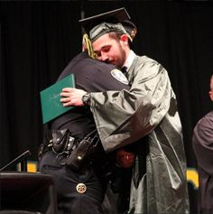 A high school senior whose parents died tragically last week graduated over the weekend. And though his mother and father couldn't be there, the police officer who broke the news of the parents' death stood onstage and embraced the graduate after he received his diploma.