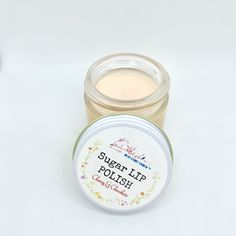LIP POLISH 1 oz. ————————-  This smooth nourishing sugar polish is created to smooth your lips with organic kinds of butter & organic brown sugar.  MAIN INGREDIENTS ——————————- This little gem contains mall particles of organic brown sugar combined with the most wonderful organic kinds of butter & oils. Let your lips be nourished by organic virgin coconut oil, organic neem seed oil,  almond oil, organic safflower oil & organic shea butter. Its consistency is soft & fluffy, exfoliation is… Butter Oil, Shea Butter, Sugar Lips, Safflower Oil, Organic Oil, Natural Flavors, 1 Oz, Consistency, Seed Oil