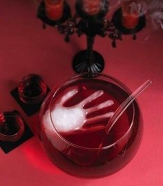 A rubber glove makes for some truly creepy ice. | 27 Incredibly Easy Ways To Upgrade Any Halloween Party