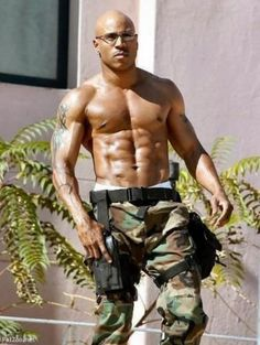 LL Cool J . love his bod. but don't like him bald…pls put something on…no no no