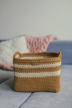 the basket looks just as pretty with or without decorations. So, that's the simplest and best DIY basket for your perfect storage solution! Diy Crochet Basket, Crochet Basket Pattern, Crochet Tote, Tote Pattern, Crochet Patterns, Nursery Storage Baskets, Laundry Basket Storage, Square Baskets, Large Baskets