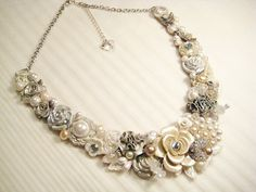Ivory Statement Necklace with Pearl Flower, Silver Accents, & Lace- Bridal Bib Necklace- Vintage Wedding Jewelry with Rhinestones and Pearls. $125.00, via Etsy.