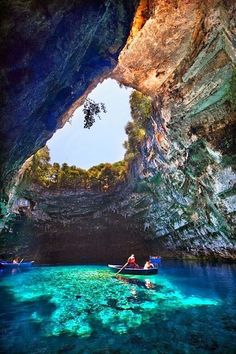 Melissani Cave - Kefalonia, Greece | near the coast, it is fed by a freshwater underground river, was discovered after an earthquake that caused the ceiling to cave in.