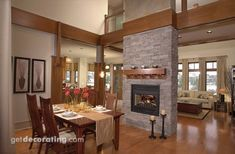 Notice how mantle is installed above stone ridge.   Fireplace between dining and living room