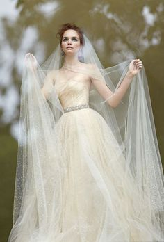 Brides.com: Winter Wedding Dresses with Stylish Coats to Match! @OscarPRGirl Click to view more details
