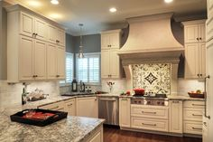 Patterned tile can pull a kitchen together in such a magical way. Kitchen Backsplash, Kitchen Cabinets, Plumbing Accessories, Kitchen Design Gallery, Custom Kitchens, Commercial Lighting, French Country Decorating, Tile Patterns, Beautiful Space