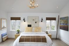 Beautiful transformation of a California bungalow. Windows on either side of the bed, make for a light, bright and airy bedroom.