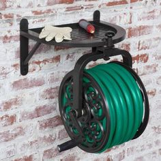 When not in use, keep your garden hose neatly stored out of the way with the Liberty Garden Navigator Rotating Hose Reel .