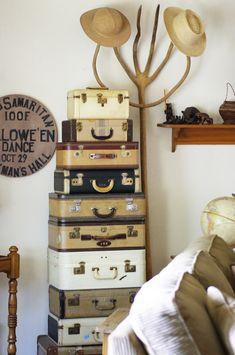 My stack of vintage suitcases, an old pitchfork I found and a  Hallowe'en Halloween sign my nephew painted for me.