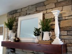 I love the simple lines of this mantle. I hope my dad can build a similar one in black for my fireplace. Maybe he could put small drawers in it and I could accessorize with some great antique pulls?