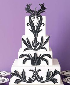 Black and white wedding ideas. Martine's, Lexington, KY    Martine Holzman saw a striking paisley print on an Indian shawl, then she and her team got to work, rendering it in fondant. Cake with raised black gum-paste damask design, 8 dollars per slice, serves 250; martinespastries.com
