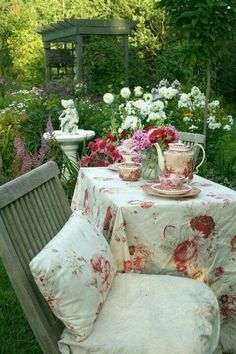 dining al fresco - red and white Vista china, shabby chic roses cloth.perfect setting for a garden tea.