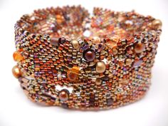Sweet freeform peyote cuff. Loving the autumn colors. by PasticheStudio on Etsy