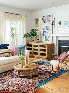 Jen installed casters on the grain cabinet before bringing it into her house. She rolled it around the main level until it found its home between the fireplace and flowy curtains. Textiles energize her living room -- this collection began with a Pinterest