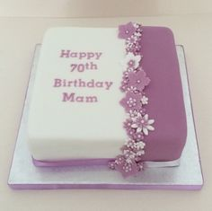 Two tone purple 70th birthday fruit cake decorated with flowers