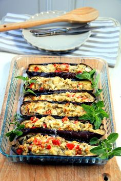 Vegetarian stuffed eggplants with goat cheese, parmesan and fresh origan. So tasty!