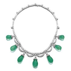 Emerald and diamond necklace, Bulgari Set with brilliant-cut and baguette diamonds, supporting seven drop-shaped emeralds capped with brilliant-cut diamonds, length approximately 420mm, signed Bulgari, pouch stamped Bulgari.