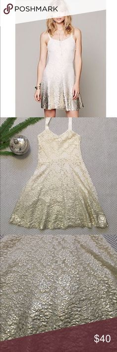Free People Reflected Moonlight Dress Free People Reflected Moonlight gold Foil and cream lace dress with grosgrain ribbon adjustable straps, hidden side zip, fully lined. Very good condition.   Measures 14 inches armpit to armpit, waist 28, length 32 Free People Dresses
