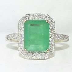 Vintage Emerald cut Emerald and Diamond Ring by LadyLibertyGold
