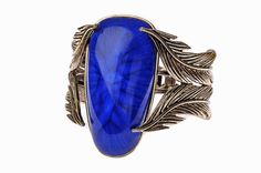 Make a statement with statement jewelery, including this cobalt blue bracelet.