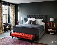 In Naomi Watts and Liev Schreiber's New York apartment, an RH bed is grouped with Ralph Lauren Home side tables and a vintage Italian bench from Billy Cotton.