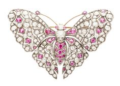 A ruby and diamond set butterfly brooch, set throughout with graduated old round cut diamonds and rubies, with cabochon ruby eyes.