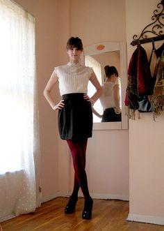 Black skirt, white top, maroon tights