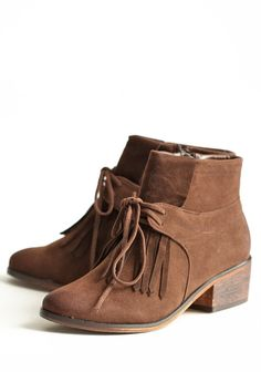 "Shopruche.com...Country Bound Ankle Boots...Luxurious deep brown faux-suede ankle boots are perfected with an oxford design and front fringe. Finished with a self-tie bow, a side zipper closure, and a 2"" faux stacked heel. $50    Slightly padded footbed  2"" heel"