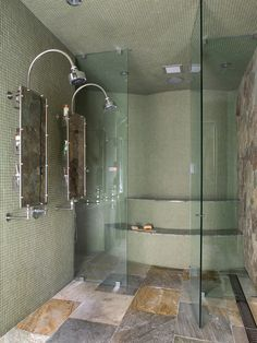 Dramatic Bathroom Interior With Stone Flooring & Walling To Combine With Tiled Wall With Industrial Showers & Mirrors For Two