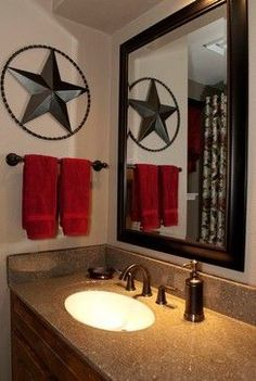 Maybe add an iron artwork piece in the bathroom. Also like the pop of red against the gold & brown | Decorating Home