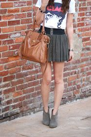 Graphic tee, skirt, and booties.