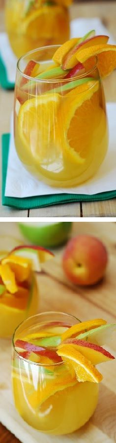 Addictive White Sangria, with peaches, green and red apples, oranges! A light and fruity drink for the Summer pool parties and cook-outs | JuliasAlbum.com | #cocktails #party_ideas