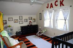 handmade area rug with Hobbes inspiration, and wall with all Calvin and Hobbes pictures, hand made comic strip window curtains with over 300 Calvin and Hobbes comic strips on them