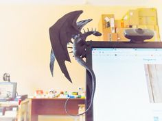 Dragon sitting on the monitor. New dragon model - http://www.thingiverse.com/thing:1541238
