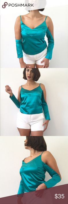 "Nwt Teal Cold shoulder Silky Top Nwt Teal Cold shoulder Silky Top, brand new with tags cold shoulder trend top. Silky material, size small. Received as gift, too snug for me.  #nwt #coldshoulder #silky #boutique #sexy #pretty #trendy Closet Details: -Offers welcome -Bundle discounts  -entire closet like new or new condition  -model 5'4"", 145lbs, 32C -no swaps Tops Blouses"