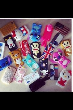 I like the British & American flags, the Coca Cola, & the top Hello Kitty case :D